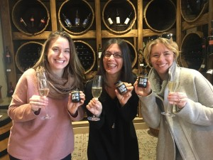 Katherine Henry, Chris Miranda and Gina Dolecki are happy to have bubbly and bacon jam at Domaine de Grand Pré in Grand Pré, NS.